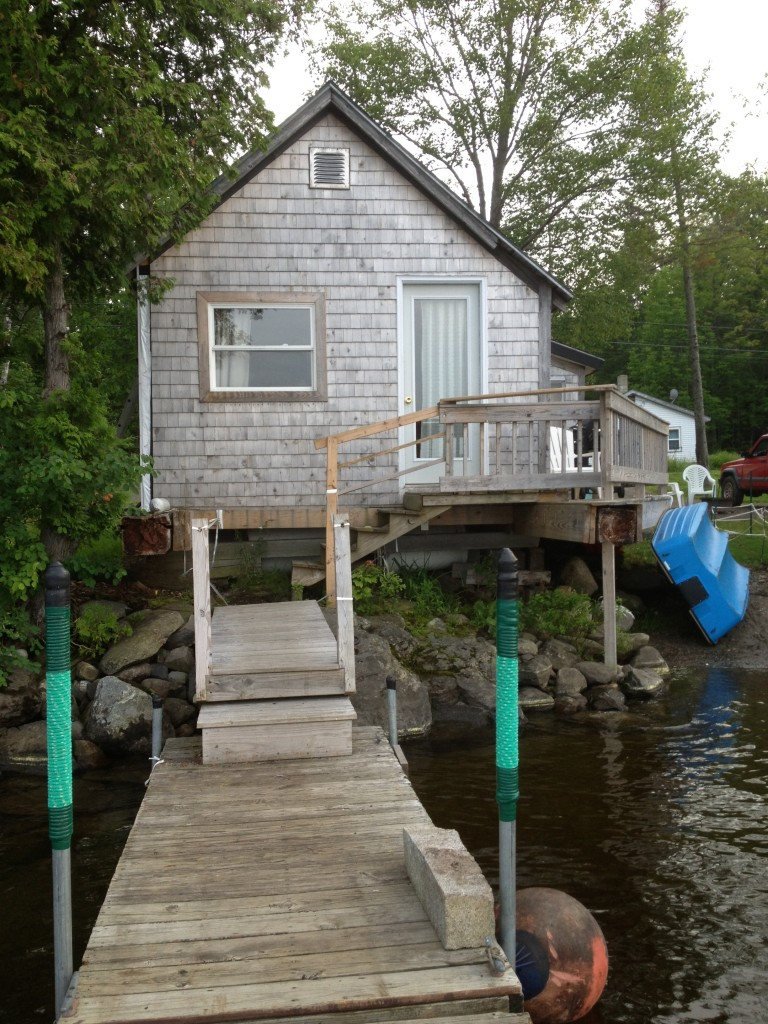 Cottage front door opens onto the large dock